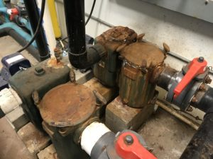 rusty pump room, rust in pump room, pool equipment rust, pump strainer rust, pump strainer, corroded pool pump, iron in pools